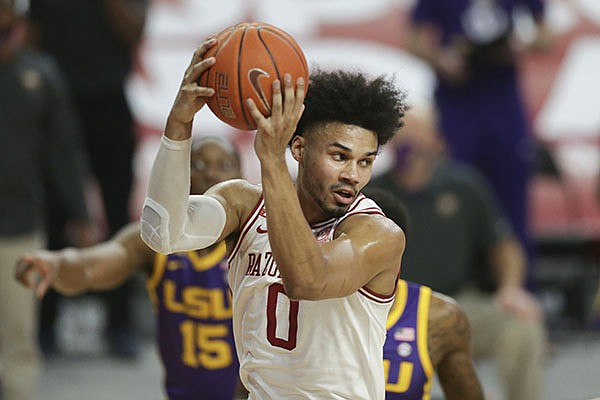 Arkansas forward Justin Smith (0) grabs a rebound during a game against LSU on Saturday, Feb. 27, 2021, in Fayetteville.
