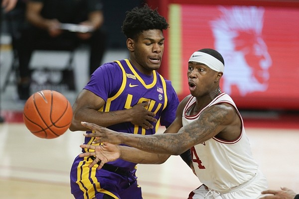 Arkansas guard Davonte Davis (4) passes, Saturday, February 27, 2021 during the first half of a basketball game at Bud Walton Arena in Fayetteville. Check out nwaonline.com/210228Daily/ for the photo gallery.