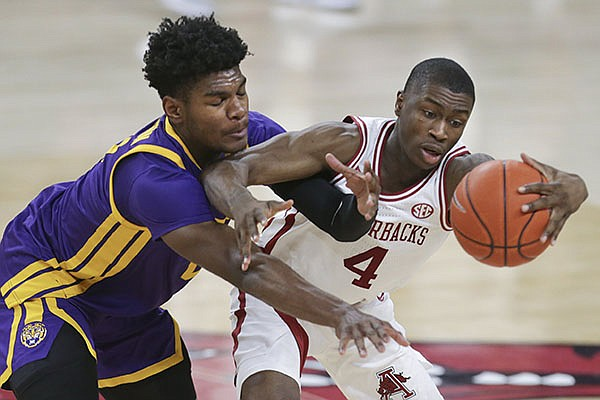 Arkansas guard Davonte Davis (4) protects the ball from LSU forward Mwani Wilkinson during a game Saturday, Feb. 27, 2021, in Fayetteville.