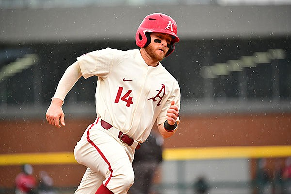 Arkansas' Cullen Smith runs toward home plate during a game against Southeast Missouri State on Sunday, Feb. 28, 2021, in Fayetteville.