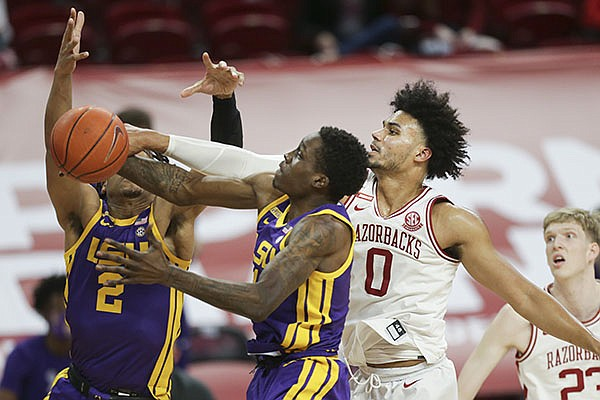 Arkansas' Justin Smith (0) attempts to block a shot during a game against LSU on Saturday, Feb. 27, 2021, in Fayetteville.