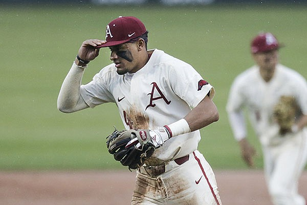 Arkansas shortstop Jalen Battles runs off the field during a game against Southeast Missouri State on Sunday, Feb. 28, 2021, in Fayetteville.