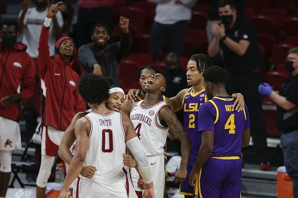 Arkansas guard Davonte Davis (4) reacts, Saturday, February 27, 2021, during the second half of a game against LSU at Bud Walton Arena in Fayetteville. Check out nwaonline.com/210228Daily/ for the game's photo gallery.