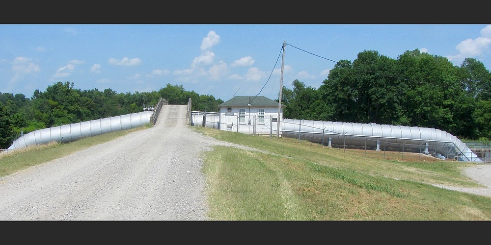 A bridge takes a road over the three tubes of Marked Tree Siphons in Poinsett County. (Special to the Democrat-Gazette/Marcia Schnedler)