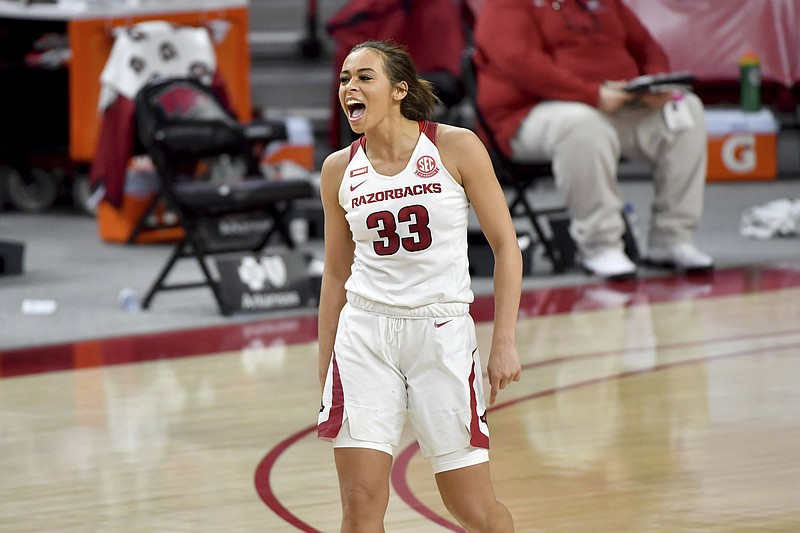 Arkansas guard Chelsea Dungee celebrates after hitting a shot against Connecticut during the second half of an NCAA college basketball game Thursday, Jan. 28, 2021, in Fayetteville, Ark. (AP Photo/Michael Woods)
