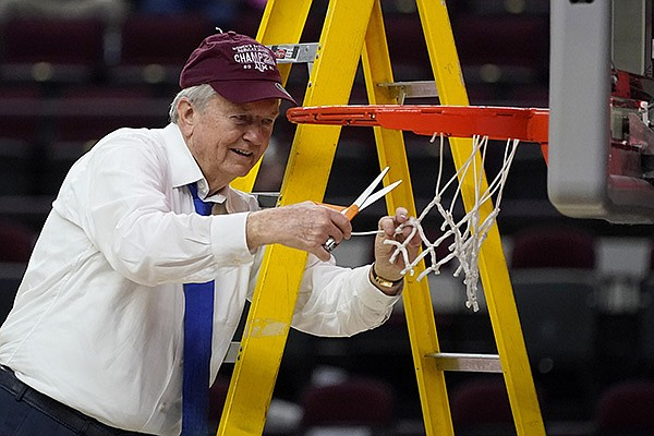 Texas A&M head coach Gary Blair cuts down the net after a win over South Carolina in an NCAA college basketball game Sunday, Feb. 28, 2021, in College Station, Texas. (AP Photo/Sam Craft)