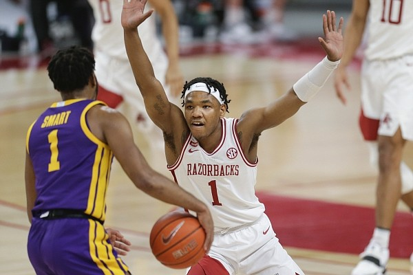 Arkansas guard JD Notae (1) blocks LSU guard Javonte Smart (1), Saturday, February 27, 2021 during the first half of a basketball game at Bud Walton Arena in Fayetteville. Check out nwaonline.com/210228Daily/ for the photo gallery.
