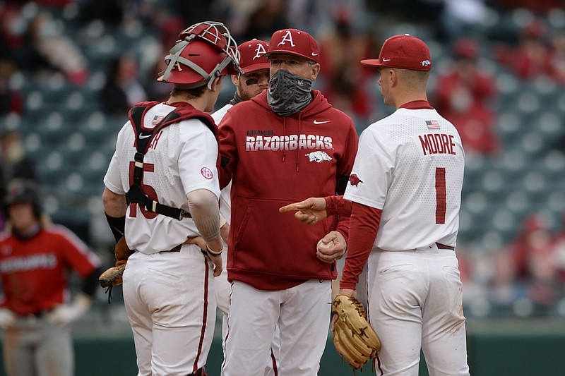 Arkansas coach Dave Van Horn speaks to his infield Friday, Feb. 26, 2021, during a pitching change against Southeast Missouri State during the fourth inning of the Razorbacks 7-3 win at Baum-Walker Stadium in Fayetteville.
