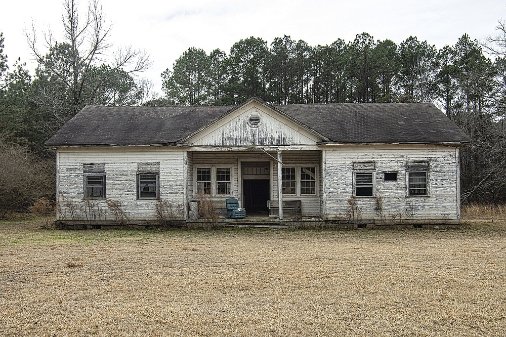 The Mt. Olive Rosenwald School, on Bradley Road 45 in Mt. Olive in Bradley County, is a wood-frame Colonial Revival schoolhouse built in 1927. The school once enjoyed a renewal as a community center, but has long been vacant and is now in a state of serious decay. (Arkansas Democrat-Gazette/Cary Jenkins)