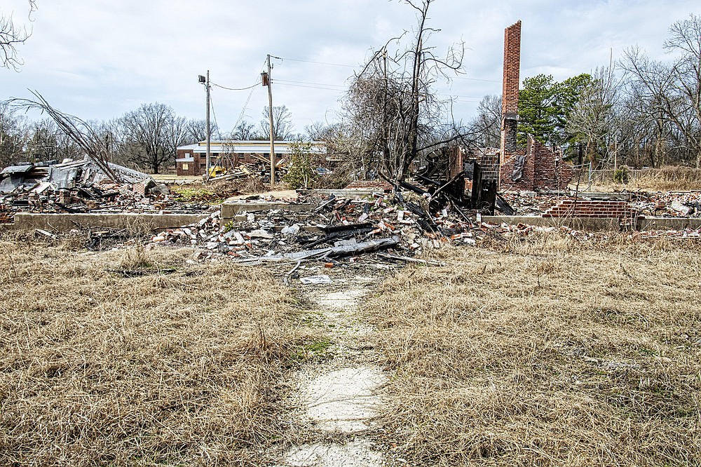 This sidewalk would have led to the front door of the Chicot County Training School, a Rosenwald School built in 1929, on the corner of Hazel and North School Streets in Dermott. The school — which served as a Head Start before becoming vacant and deteriorating — collapsed and burned, according to Dermott Mayor Walter Donald. (Arkansas Democrat-Gazette/Cary Jenkins)
