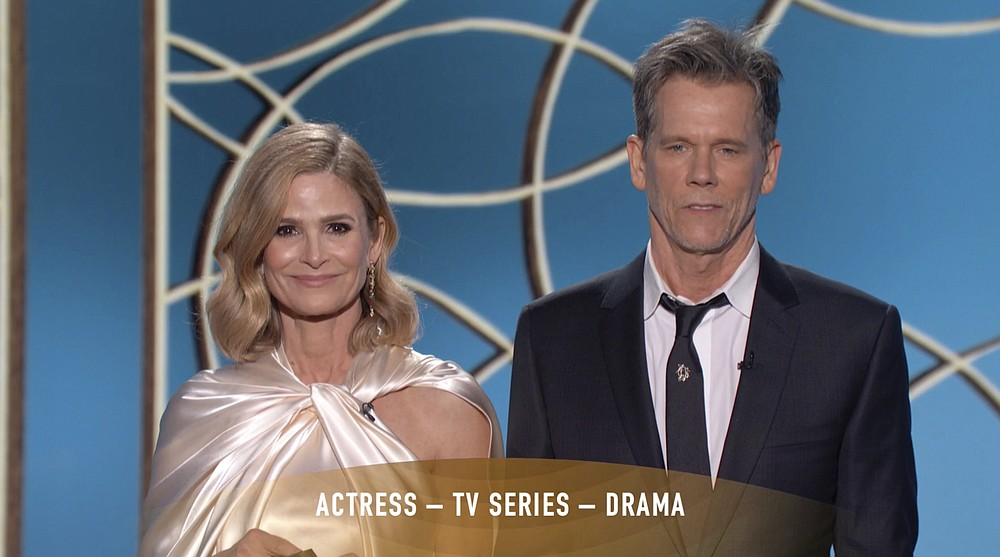Kyra Sedgwick (left) and Kevin Bacon present the award for Best Actress in a Television Drama Series at the Golden Globe Awards. (NBC via AP)