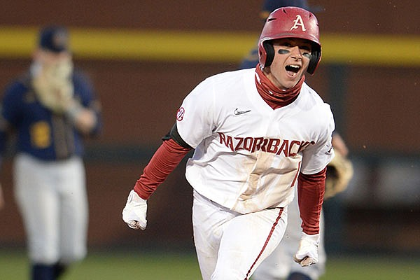 Arkansas second baseman Robert Moore celebrates Friday, March 5, 2021, after hitting a two-run home run to give the Razorbacks a 7-6 lead over Murray State during the eighth inning of the Razorbacks' 7-6 win in Baum-Walker Stadium in Fayetteville.