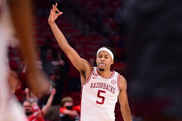 Arkansas guard Moses Moody celebrates after making a three-pointer late in the second half of the Razorbacks' victory over Texas A&M on March 6, 2021, in Bud Walton Arena in Fayetteville.