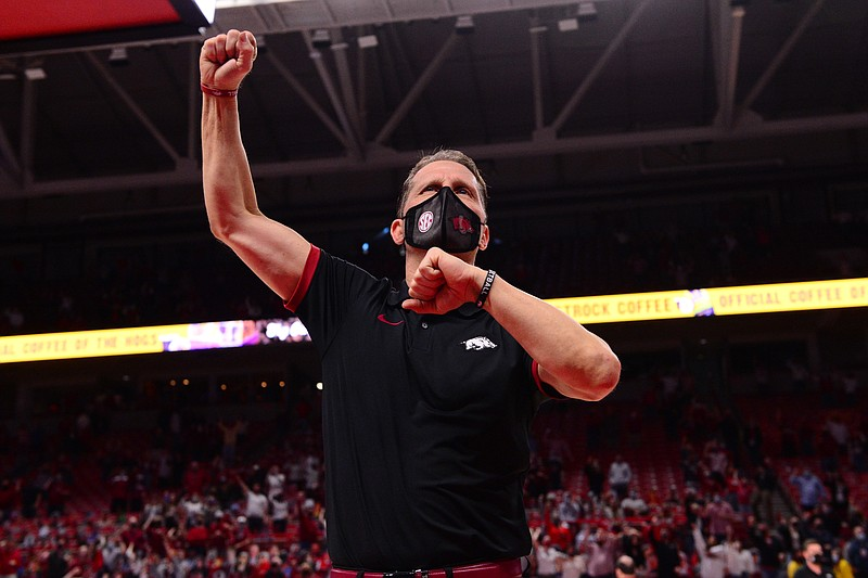 Arkansas coach Eric Musselman celebrates after Arkansas' 87-80 win over Texas A&M in Bud Walton Arena in Fayetteville on Saturday, Mar. 6, 2021. Photo courtesy Gunnar Rathbun via the SEC Media Pool.
