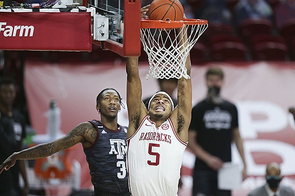 Arkansas guard Moses Moody (5) dunks during a game against Texas A&M on Saturday, March 6, 2021, in Fayetteville.