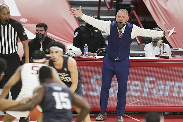 Texas A&M coach Buzz Williams directs his players during a game against Arkansas on Saturday, March 6, 2021, in Fayetteville.