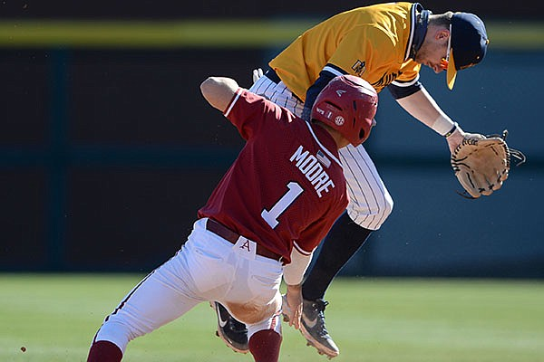 Arkansas second baseman Robert Moore (right) slides in safely at second Saturday, March 6, 2021, as he collides with Murray State second baseman Jordan Cozart who misplays the throw from the plate during the sixth inning of the Hogs' 11-6 win at Baum-Walker Stadium in Fayetteville.