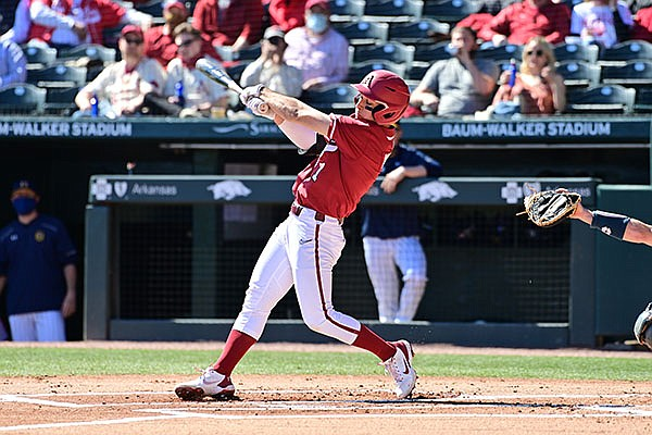 Arkansas second baseman Robert Moore bats during a game against Murray State on Saturday, March 6, 2021, in Fayetteville.