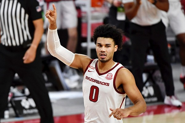 Arkansas forward Justin Smith (0) reacts after scoring against Auburn during the second half of a game on Wednesday, Jan. 20, 2021, in Fayetteville. (AP Photo/Michael Woods)