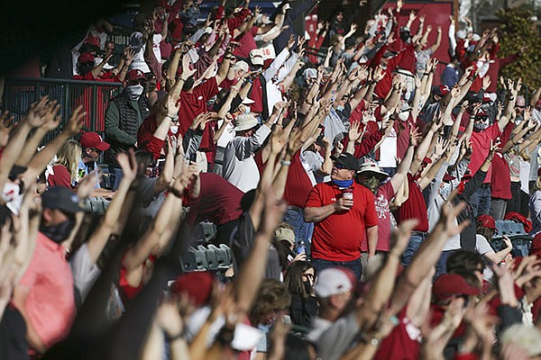 Arkansas baseball fans call the Hogs during a game against Murray State on Sunday, March 7, 2021, in Fayetteville.
