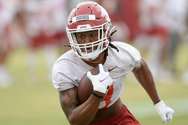 Arkansas receiver Mike Woods runs after the catch during a practice on March 11, 2021, in Fayetteville.