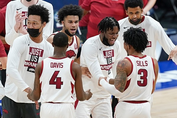 Arkansas forward Jaylin Williams (left) celebrates with teammates after the Razorbacks defeated Missouri in the Southeastern Conference Tournament on Friday, March 12, 2021, in Nashville, Tenn. (AP Photo/Mark Humphrey)