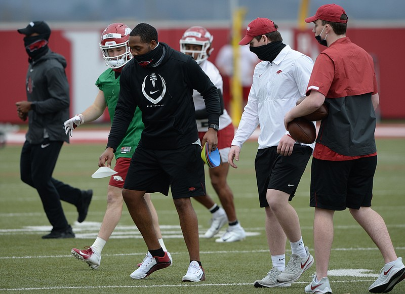 Arkansas receivers coach Kenny Guiton directs his players Tuesday, March 9, 2021, during practice at the university practice field in Fayetteville. Visit nwaonline.com/210310Daily/ for today's photo gallery. .(NWA Democrat-Gazette/Andy Shupe)