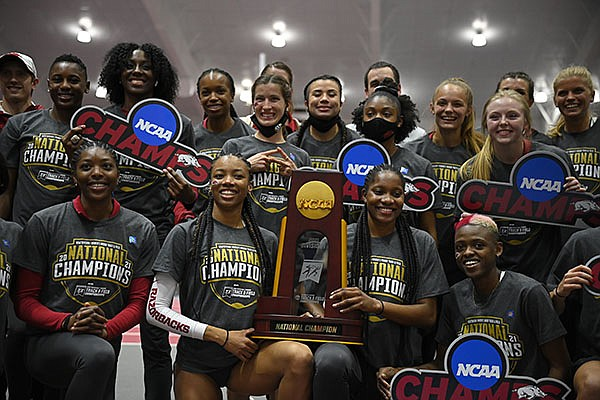 Members of Arkansas' track and field team celebrate their NCAA indoor championship on Saturday, March 13, 2021, in Fayetteville.