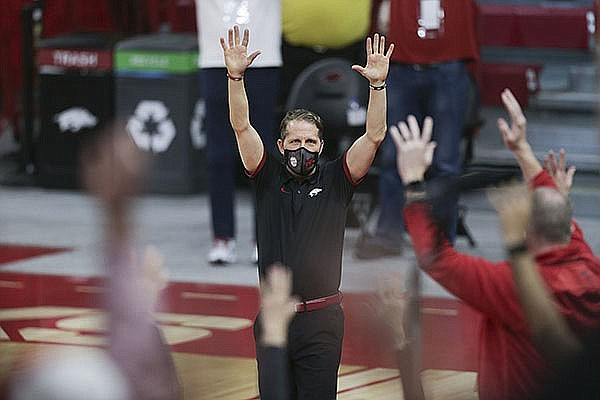 Arkansas coach Eric Musselman leads a Hog Call following the Razorbacks' 87-80 victory over Texas A&M on Saturday, March 6, 2021, in Fayetteville.