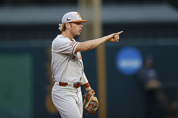 Texas second baseman Brenden Dixon (1) points during an NCAA college baseball game against Rice, Saturday, Feb. 15, 2020, in Houston. (AP Photo/Aaron M. Sprecher)