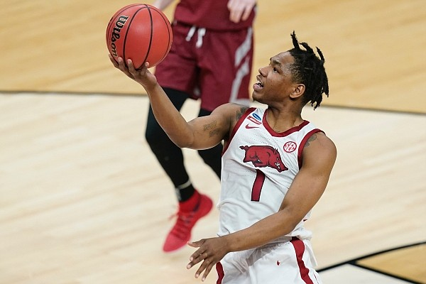 Arkansas' JD Notae (1) puts up a shot during the second half of a first round game against Colgate at Bankers Life Fieldhouse in the NCAA men's college basketball tournament, Friday, March 19, 2021, in Indianapolis. (AP Photo/Darron Cummings)