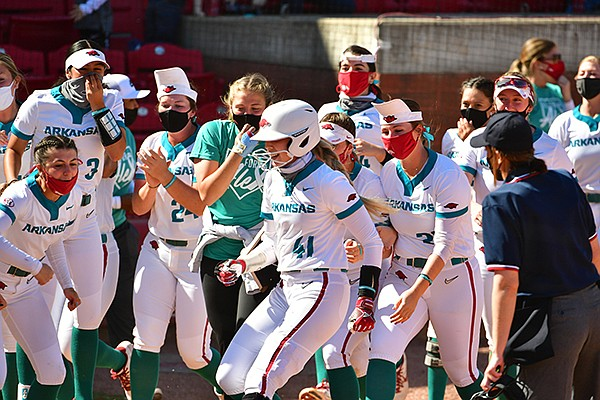 Arkansas' Danielle Gibson is met at the plate after she hit a game-winning home run to defeat Ole Miss on Saturday, March 20, 2021, in Fayetteville.