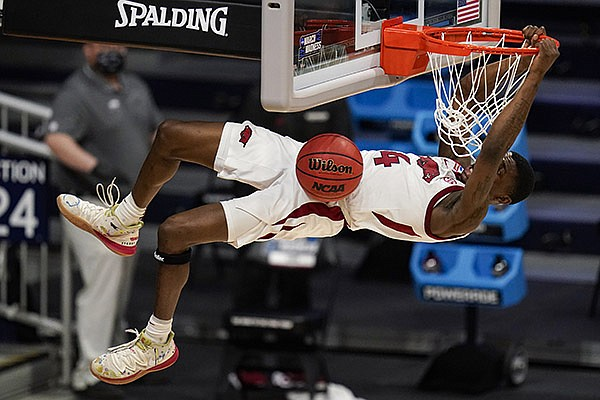 Arkansas guard Davonte Davis (4) gets a dunk against Texas Tech in the second half of a second-round game in the NCAA men's college basketball tournament at Hinkle Fieldhouse in Indianapolis, Sunday, March 21, 2021. (AP Photo/Michael Conroy)