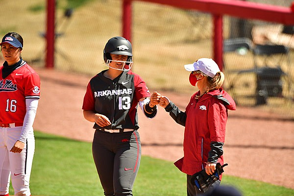 Arkansas catcher Kayla Green (13) is shown during a game against Ole Miss on Sunday, March 21, 2021, in Fayetteville.