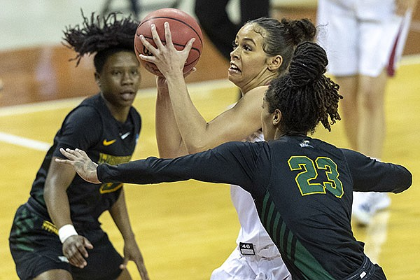 Wright State guard Emani Jefferson, right, defends Arkansas guard Makayla Daniels, left, during the first half of a college basketball game in the first round of the women's NCAA tournament at the Frank Erwin Center in Austin, Texas, Monday, March 22, 2021. (AP Photo/Stephen Spillman)