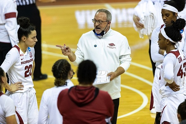 Arkansas head coach Mike Neighbors speaks with his team in a time out against Wright State during the second half of a college basketball game in the first round of the women's NCAA tournament at the Frank Erwin Center in Austin, Texas, Monday, March 22, 2021. (AP Photo/Stephen Spillman)