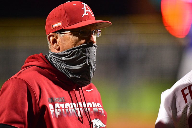 Dave Van Horn talks to Christian Franklin during Arkansas' 14-1 win over Memphis on Tuesday, March 23, 2021 at Baum-Walker Stadium in Fayetteville. Picture courtesy SEC Media pool.