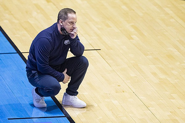 Oral Roberts head coach Paul Mills looks on during the second half of a first-round game against Ohio State in the NCAA men's college basketball tournament, Friday, March 19, 2021, at Mackey Arena in West Lafayette, Ind. Oral Roberts won in overtime. (AP Photo/Robert Franklin)