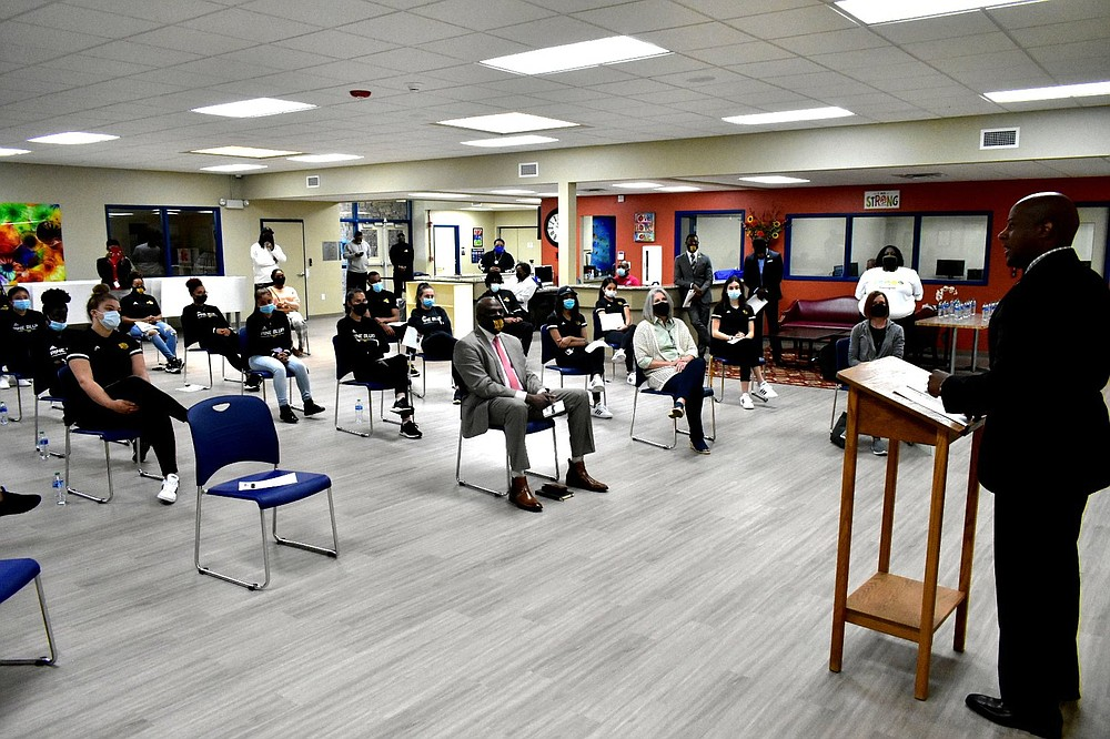 Pine Bluff Parks and Recreation Director Samuel Glover speaks with UAPB student-athletes during a check presentation inside the Pine Bluff Community Center on Wednesday.  (Pine Bluff Commercial/I.C. Murrell)