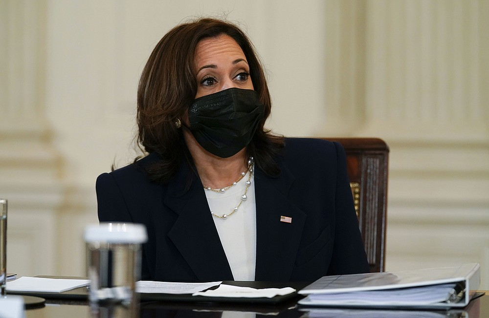 """Vice President Kamala Harris attends a White House meeting on immigration efforts Wednesday. Harris, who will lead efforts to deal with the growing problem, said: """"While we are clear that people should not come to the border now, we also understand that we will enforce the law and that we also — because we can chew gum and walk at the same time — must address the root causes that cause people to make the trek."""" (AP/Evan Vucci)"""