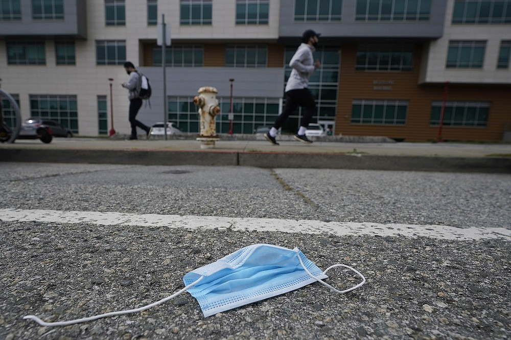 Discarded masks, like this one on a street Wednesday in San Francisco, and other used protective equipment are contributing to a worldwide environmental problem. (AP/Jeff Chiu)