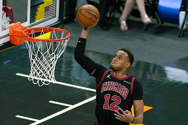 Chicago Bulls forward Daniel Gafford (12) attempts a shot during the first half of a game against the Orlando Magic on Saturday, Feb. 6, 2021, in Orlando, Fla. (AP Photo/John Raoux)