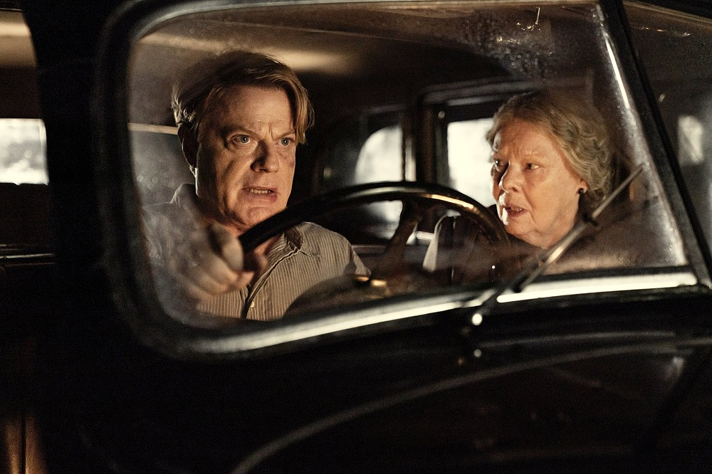 "Thomas Miller (Eddie Izzard) and headmistress Helene Rocholl (Judi Dench) race against time to foil a Nazi plot in ""Six Minutes to Midnight."""