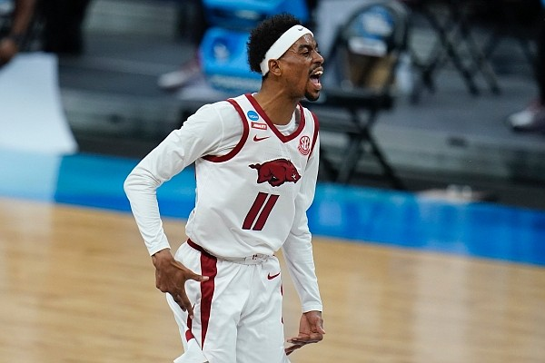 Arkansas guard Jalen Tate celebrates during the first half of a Sweet 16 game against Oral Roberts in the NCAA men's college basketball tournament at Bankers Life Fieldhouse, Saturday, March 27, 2021, in Indianapolis. (AP Photo/Jeff Roberson)