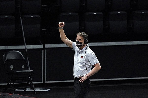Arkansas head coach Eric Musselman celebrates after a Sweet 16 game against Oral Roberts in the NCAA men's college basketball tournament at Bankers Life Fieldhouse, Saturday, March 27, 2021, in Indianapolis. Arkansas won 72-70. (AP Photo/Jeff Roberson)