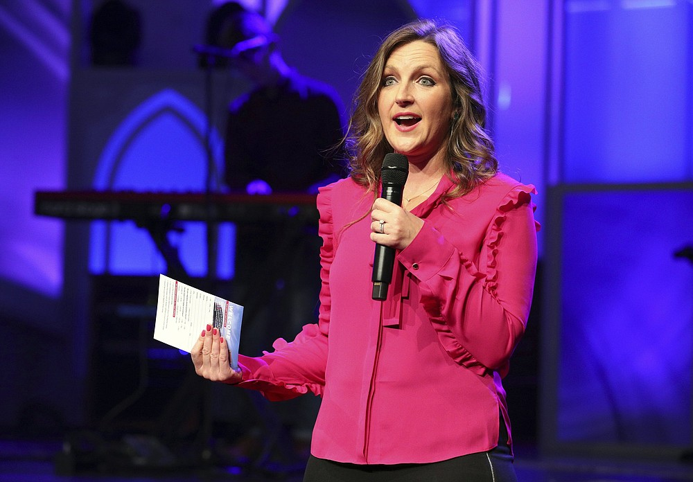 Julia Jeffress Sadler speaks during the contemporary service at First Baptist Dallas in Dallas on Sunday. The outspoken conservative pastor, Robert Jeffress, has encouraged his daughter, Sadler, to be active in ministry, even though he cautioned her at age 11 that she couldn't hold the title of pastor. (AP/Richard W. Rodriguez)