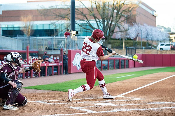 Arkansas' Linnie Malkin (22) hits a home run during a game against Mississippi State on Friday, March 26, 2021, in Fayetteville. (Photo by David Beach/Special to the Democrat-Gazette)