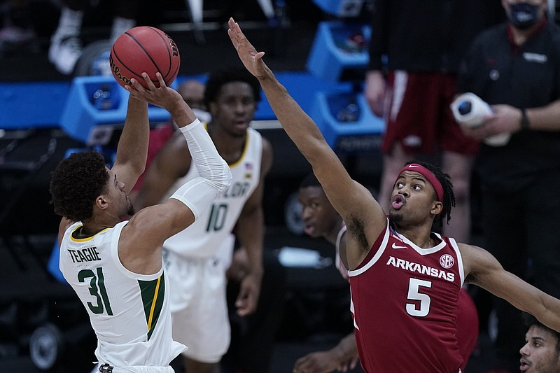 Baylor guard MaCio Teague (31) shoots on Arkansas guard Moses Moody (5) during the first half of an Elite 8 game in the NCAA men's college basketball tournament at Lucas Oil Stadium, Monday, March 29, 2021, in Indianapolis. (AP Photo/Michael Conroy)