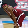 Arkansas guard Moses Moody (5) looks to the scoreboard during the second half of an Elite 8 game against Baylor in the NCAA men's college basketball tournament at Lucas Oil Stadium, Tuesday, March 30, 2021, in Indianapolis. Baylor won 81-72. (AP Photo/Darron Cummings)
