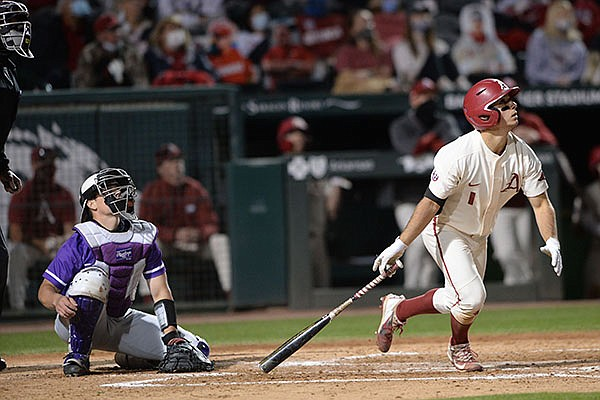 Arkansas second baseman Robert Moore watches Tuesday, March 30, 2021, as the ball hits the scoreboard for a solo home run during the fifth inning of play against Central Arkansas in Baum-Walker Stadium in Fayetteville.